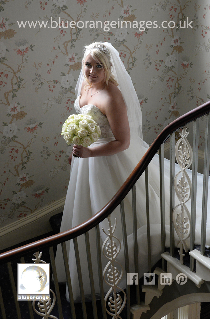 Bride on stairs St Michael's Manor Hotel, St Albans