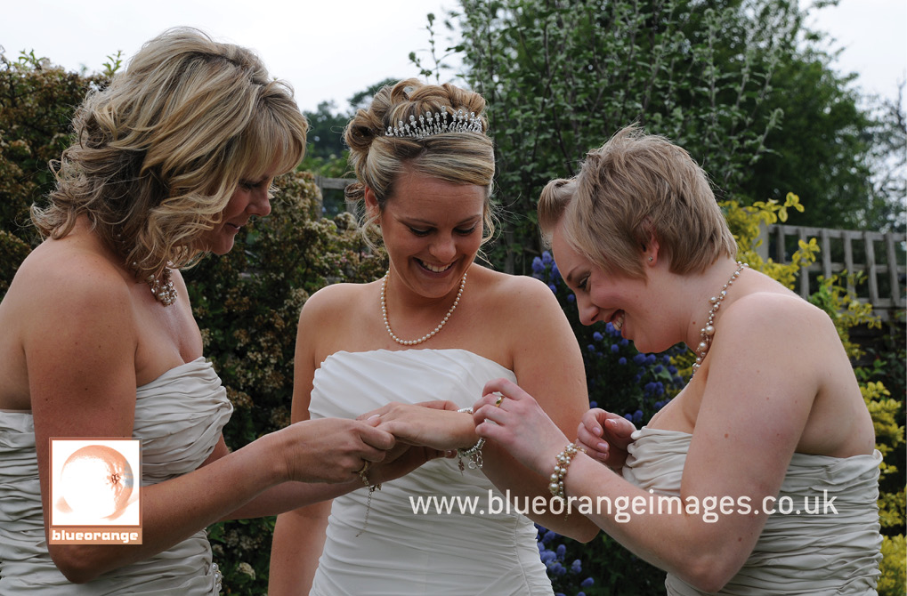 Bridesmaids and bride, getting ready for the wedding