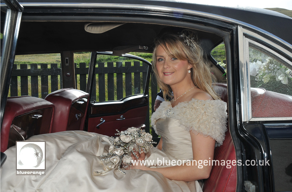 The bride and the vintage wedding car
