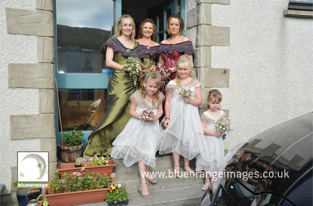 The bridesmaids and the flower girls, competing with the wind, ready to go to the church