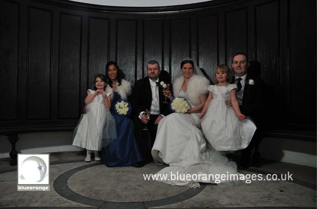 The bridal party (bride, groom, bestman, bridesmaid and flower girls