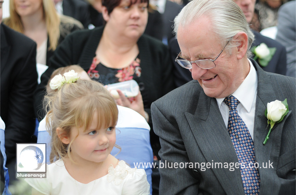 Father of the groom, with grand daughter, and Chrissie & Jon's wedding. Hunton Park, Watford