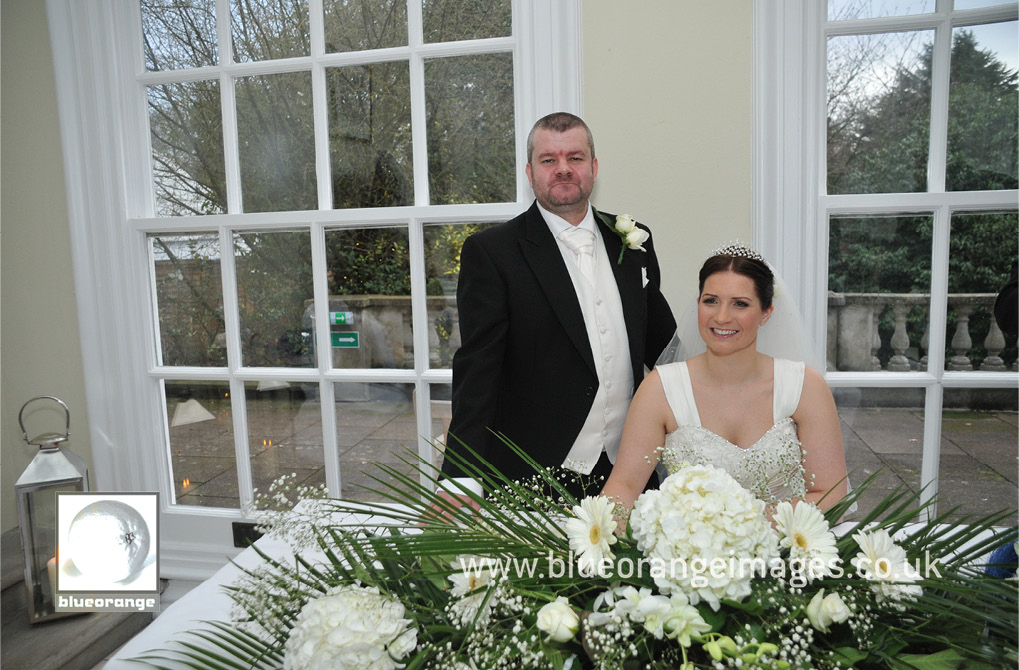 Bride & groom, Chrissie & Jon, at the ceremony in The Orangery. Hunton Park, Watford
