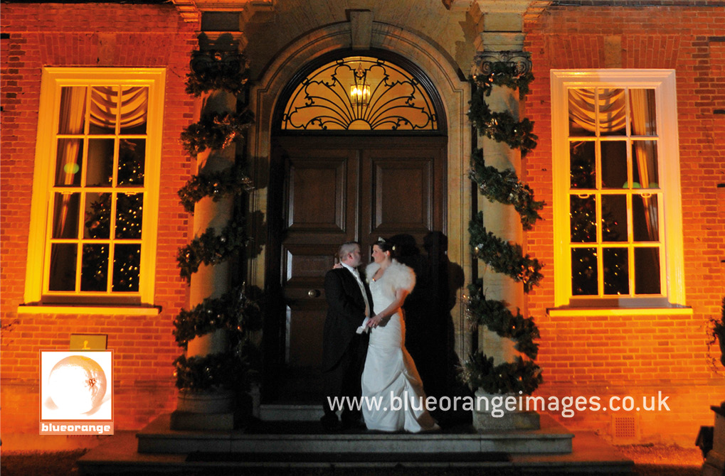 Wedding at Hunton Park venue – the bride and groom at the amazing and elegant main entrance