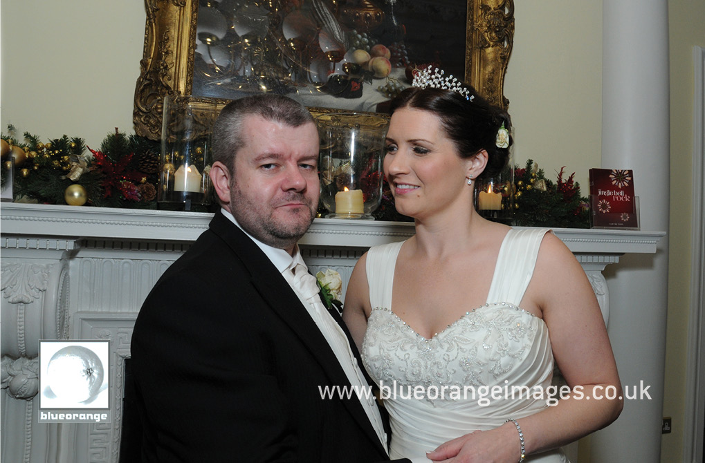 Wedding at Hunton Park venue – bride and groom photo at mantlepiece, evening photos