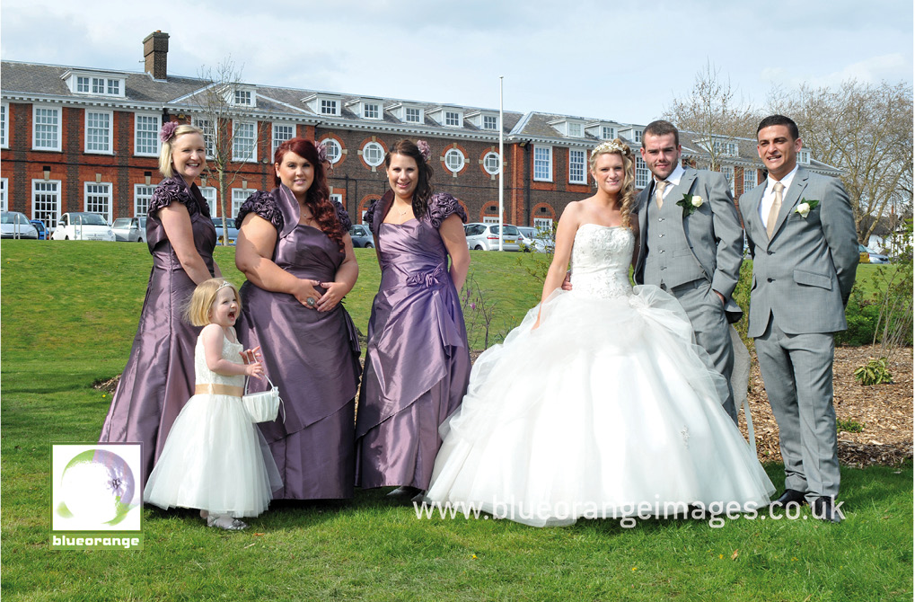 The bride, groom, bridesmaids, flower girl & best man