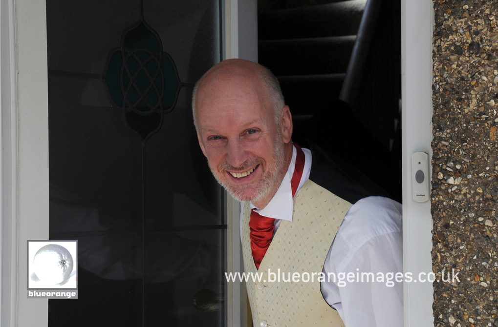 The father of the bride, at the family home's front door