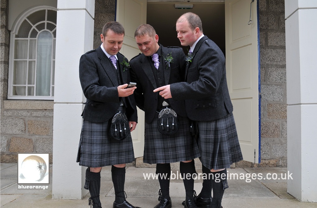 The groom and best men – looking pretty amazing in their kilts, at the church before the wedding