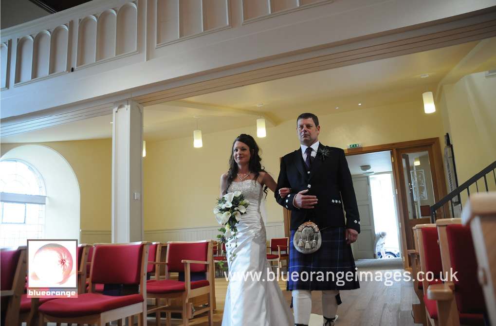 Ashleigh making her way up with the aisle, with her proud father