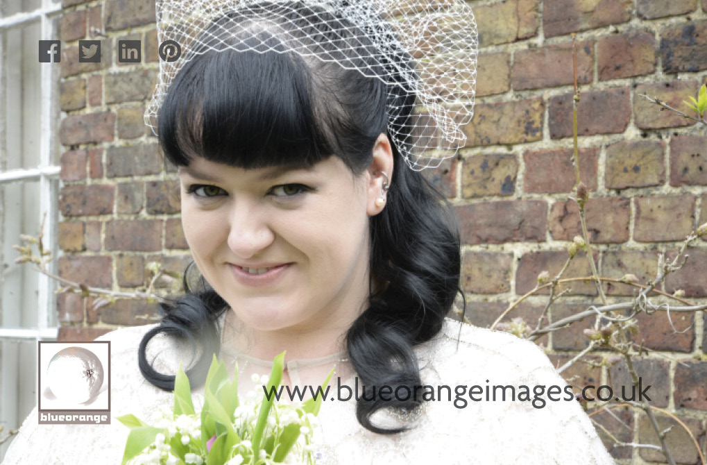 Carrie the bride, in the Watford register office garden, after the wedding