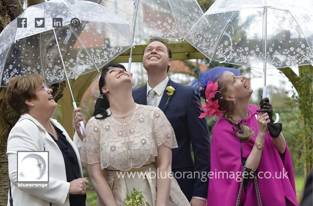 Carrie & Matt's wedding, looks like rain – thanks Mum for the umbrellas! At Watford registry office