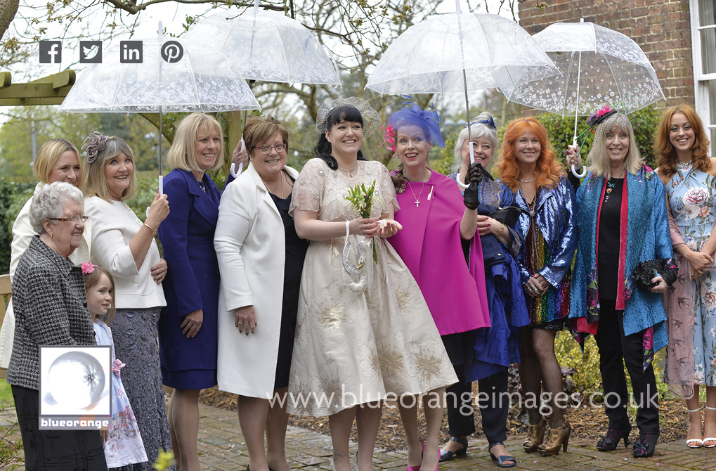 Carrie, the bride and the girls with umbrellas, at her Watford registry office wedding