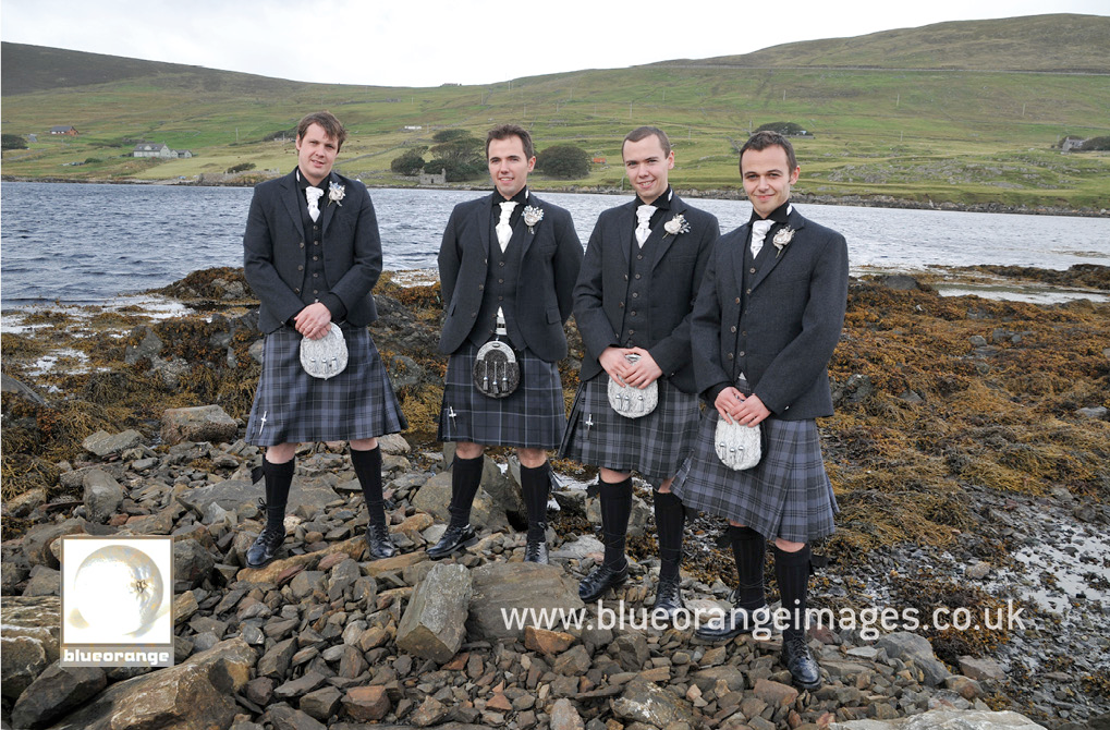 The groom and the best men, in Weisdale before the wedding ceremony, making the most of Shetland's rugged beauty
