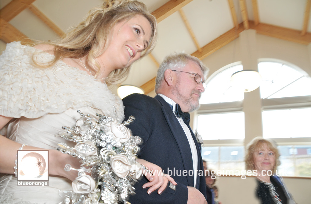 The arrival of the bride, Naomi and her Dad walking up the aisle
