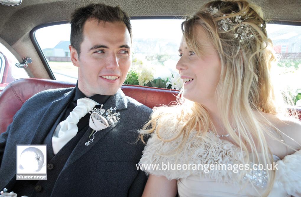 Bride & groom in the vintage wedding car