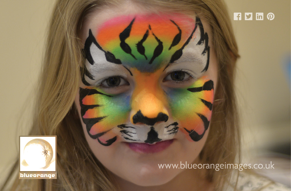 Blue Orange Images face painting: tiger face design
