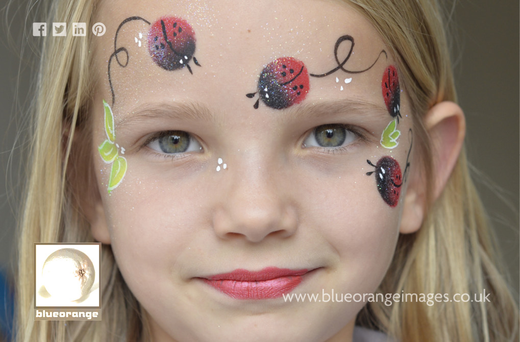 Blue Orange Images face painting: ladybird design