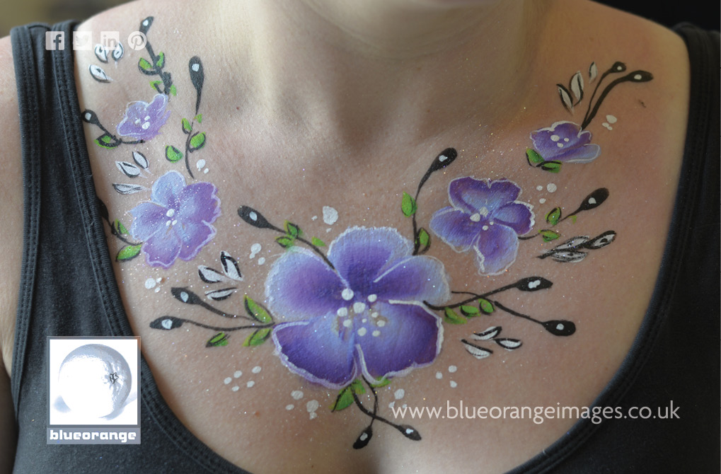 Blue Orange Images face painting: body flower design